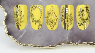 Matte and shiny vivid yellow nail art with flowers