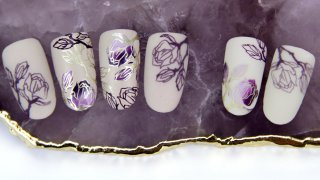 Purple flowers prepared with layered stamping