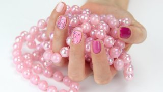 Pink gel polish nails with hand painted motifs