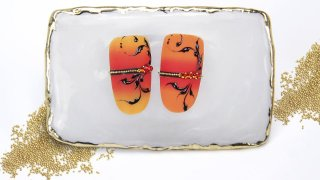 Ombre nails with nail art sticker, beads, tendrils