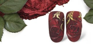 Stamped rose on red magnetic pigment powder